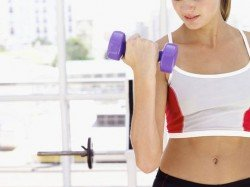 personal training sessions in Abu Dhabi with free weights
