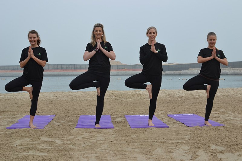 Abu Dhabi personal trainer leila knight - group yoga pose 3