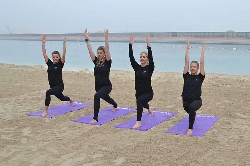 Abu Dhabi personal trainer leila knight - group yoga pose 1
