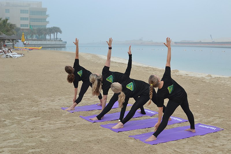 Abu Dhabi personal trainer leila knight - group yoga pose 2