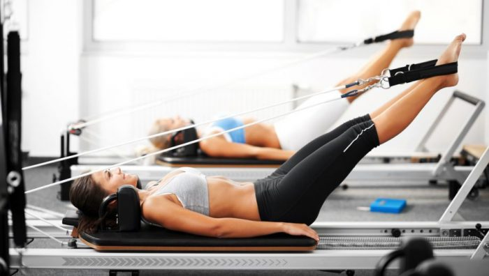 Working out the legs with the pilates reformer in Abu Dhabi and Dubai