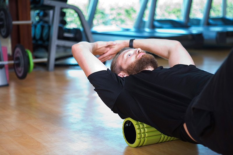Abu Dhabi personal trainer Chris - back muscle rolling example