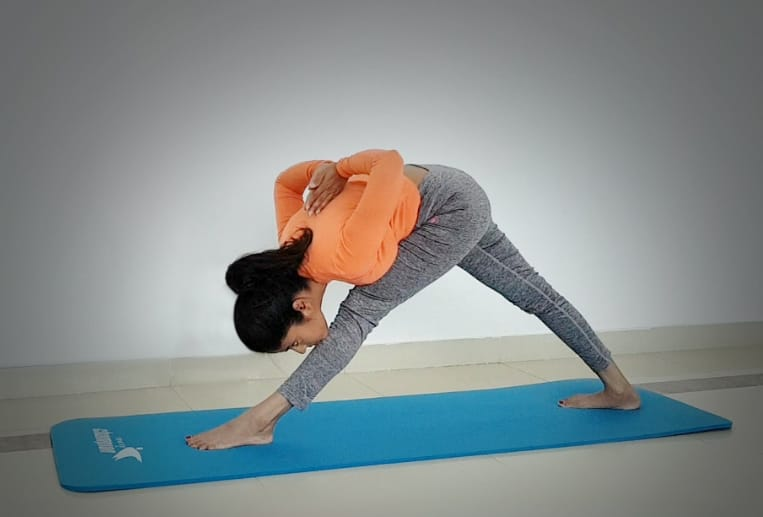Abu Dhabi Yoga Coach Shweta - Parsvottan asana (Intense side stretch) 2