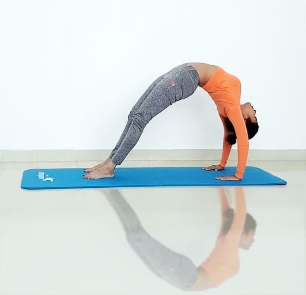 Abu Dhabi Yoga Coach Shweta - Urdhva dhanurasana - upside bow (wheel) pose 2
