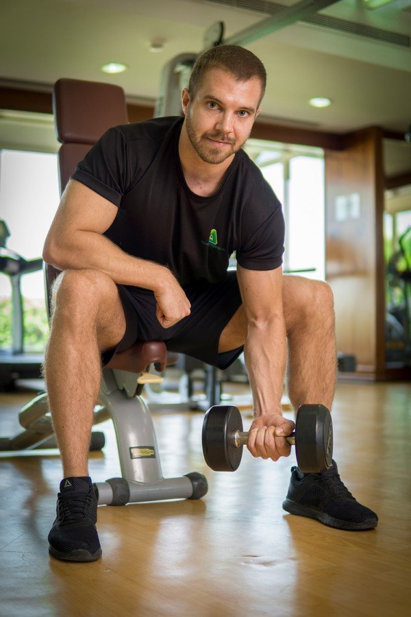 Abu Dhabi male PT ryan - dumbbell workouts at home 3
