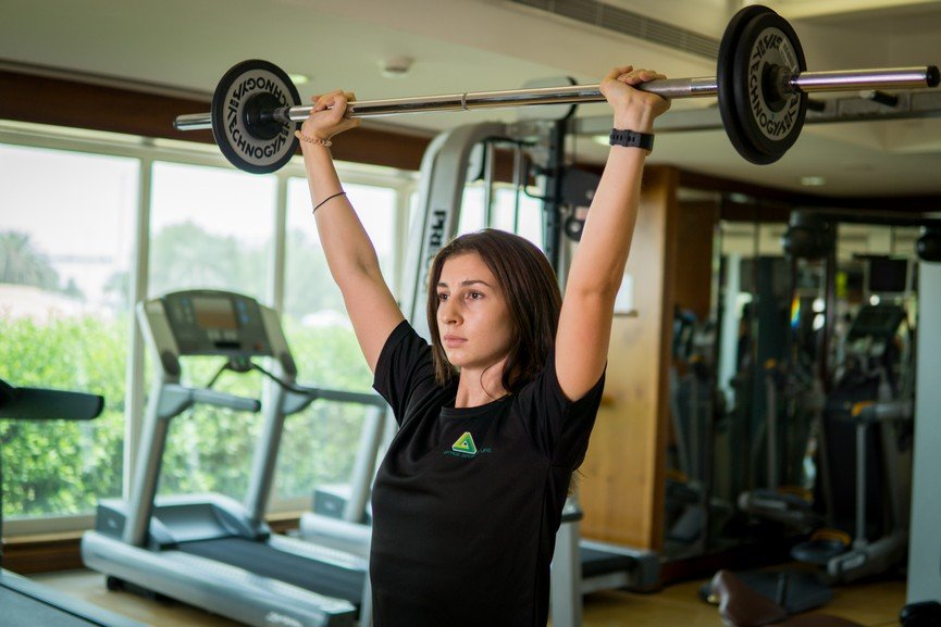 Vanessa - Abu Dhabi Trainer Working Out Barbell