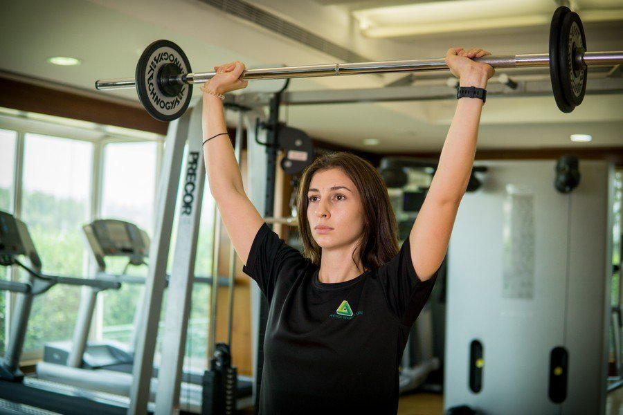 Vanessa - Abu Dhabi Trainer Working Out With Barbell 2
