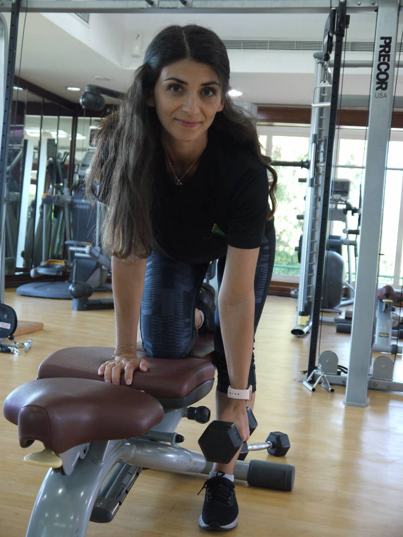 abu dhabi female fitness personal trainer nermin weight training